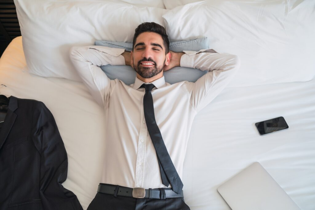 Businessman taking a break from work at hotel room.